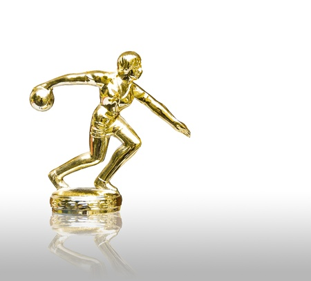 golden bowling player statue isolated on white background photo