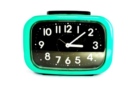 old square green alarm clock isolated on white background photo