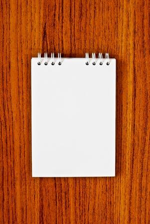 blank notebook on wood background photo