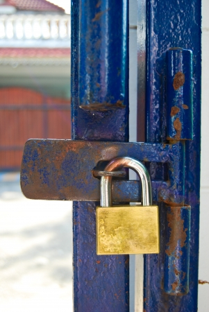 old rusty metal door gate key locked Stock Photo - 8615113