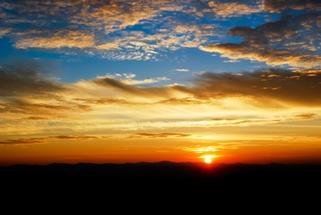 beautiful twilight sunrise on the cloudy sky , taken from the high moutain view point photo