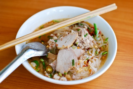 Asian style noodle with pork , spicy and yummy delicious photo