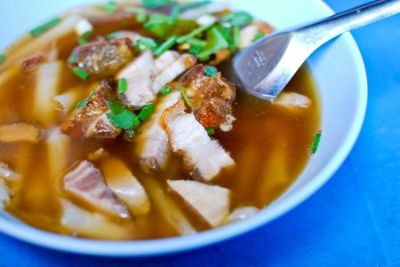 Asian style boiled square pasta soup with pork photo