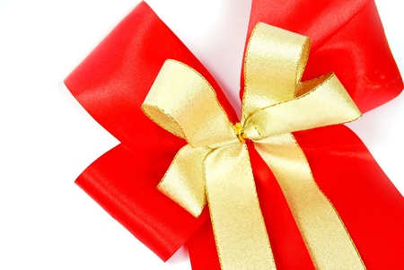 tight focus: red and gold ribbon bow isolated on white background Stock Photo