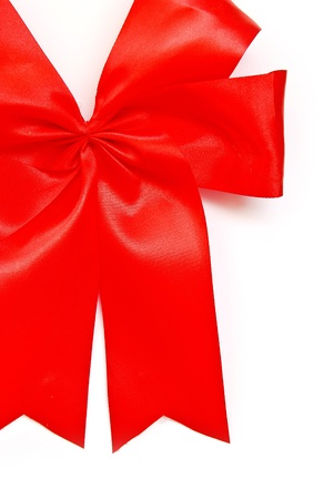 tight focus: red satin fabric ribbon bow isolated on white background