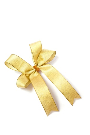 tight focus: satin gold fabric ribbon bow isolated on white background Stock Photo