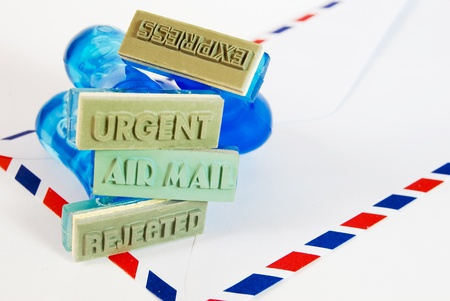 urgent, express, air mail, reject letter on rubber stamp on air mail envelope background photo