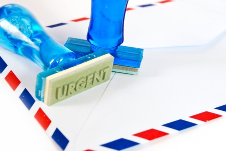 urgent letter on rubber stamp on air mail envelope on white background Stock Photo - 8801303