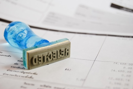 reject letter on rubber stamp with business cash receipt background Stock Photo - 8801300