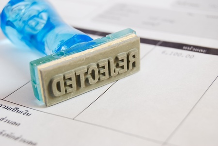 reject letter on rubber stamp with business cash receipt background Stock Photo - 8801305