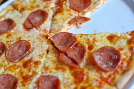 Pepperoni pizza on white dish , served hot , closeup view , original from italian restaurant photo