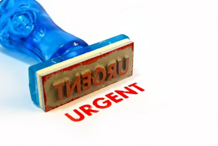 urgent letter on blue rubber stamp isolated on white background photo