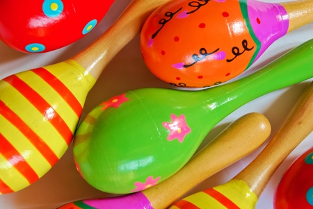 colorful wooden toy maracas music percussion instrument for kid and children play on white background closeup view photo