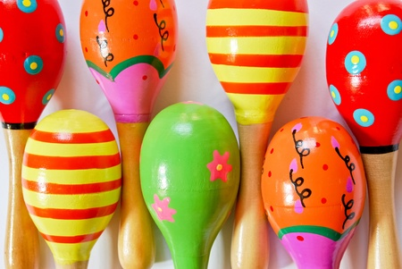 colorful wooden toy maracas music percussion instrument for kid and children play on white background closeup view Stock Photo