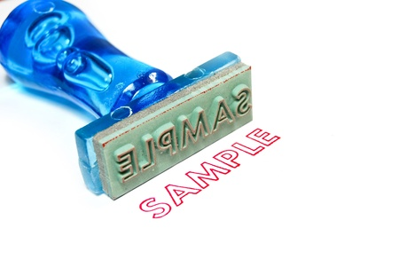 instance: sample letter on blue rubber stamp isolated on white background