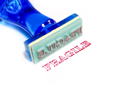 fragile letter on blue rubber stamp isolated on white background photo