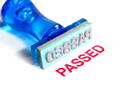 passed stamp: passed letter on blue rubber stamp isolated on white background