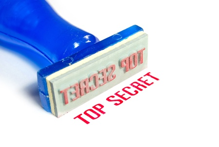 top secret letter on blue rubber stamp isolated on white background photo