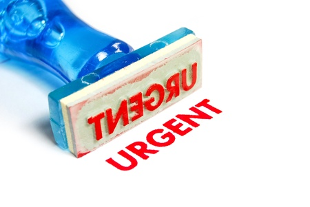 urgent letter on blue rubber stamp isolated on white background Stock Photo - 8797471