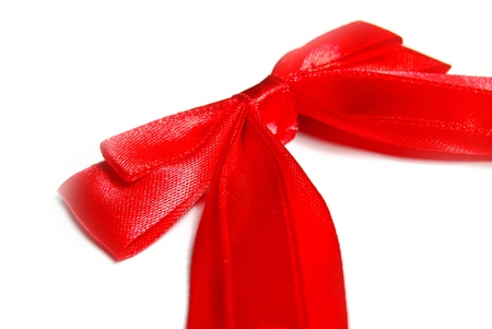 tight focus: red fashion ribbon bow isolated on white background