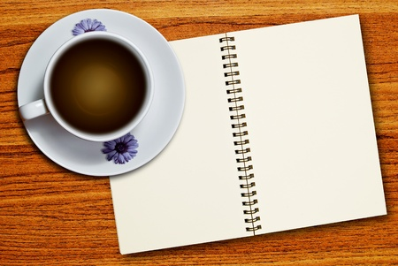 White cup of coffee and blank page notebook on wood table background Stock Photo - 8801491