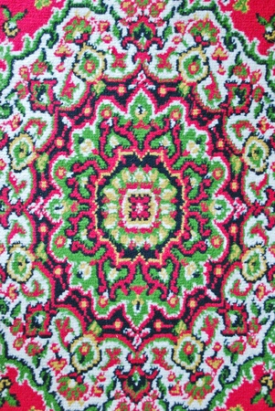 Batik fabric carpet with asian style oriental pattern background texture photo