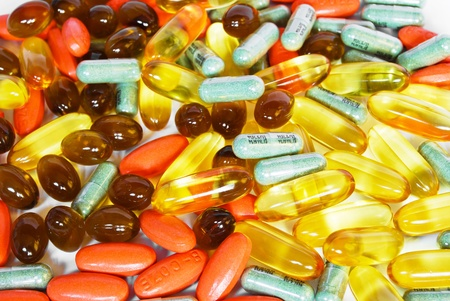 colorful vitamin and medicine pills closeup on white background