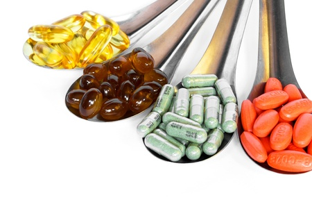 spoon with colorful vitamin medicine pills on white background Stock Photo - 9155031