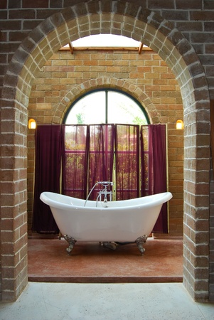 interior of vintage bathroom with bathtub in brick wall decoration room photo