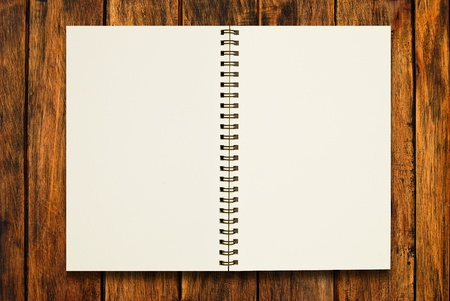 blank notebook open two pages on natural wood texture background photo