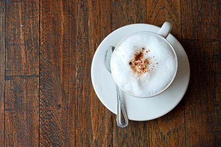 cup of coffee cappuccino on vintage wood background photo