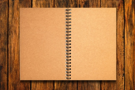 blank notebook open two pages on natural wood texture background Stock Photo - 9311179