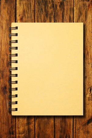 the notebook on natural wood texture background Stock Photo - 9311189