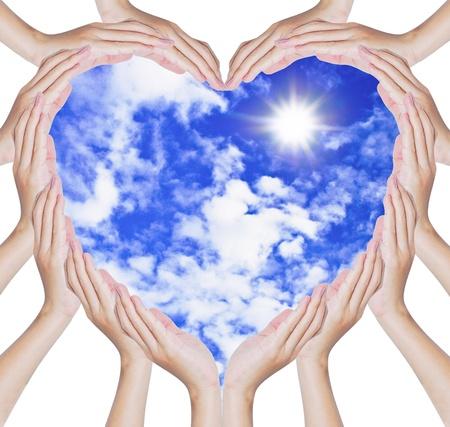 Hands make heart shape around blue sky background Stock Photo - 9379640