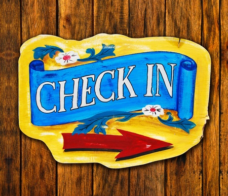 Check in letter on wood board on wood texture background Stock Photo - 9603355