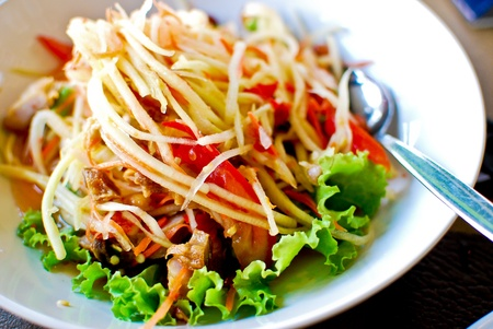 Thai style food , spicy papaya salad , also know as  som tam  photo