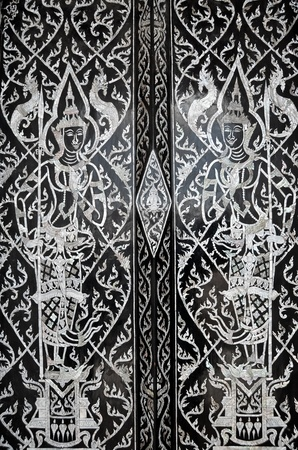 Traditional Thai style painting art on door in Buddha Temple
