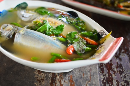 Spicy mackerel fish soup , Thai style food also know as  Tom yum  photo