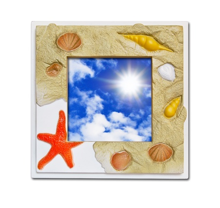 fish spa: Frame of sea shell on blue sky background