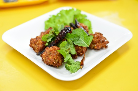 Spicy fried pork ball , Thai style food photo