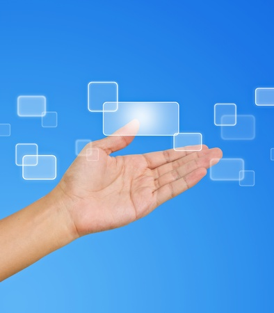Flow of buttons on hand on blue background Stock Photo - 9727581