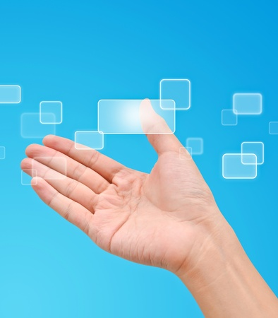 Flow of buttons on hand on blue background Stock Photo - 9727582