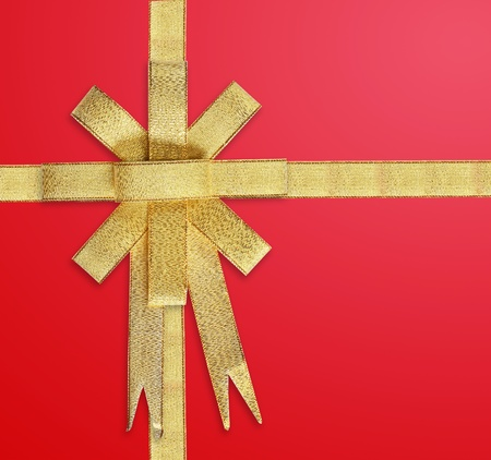Satin Gold ribbon on red background Stock Photo - 9991083
