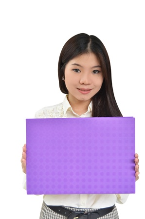 Business woman holding a message board isolated on white background Stock Photo - 10444460
