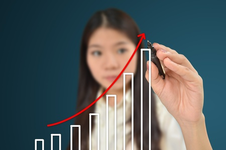 population growth: Business woman drawing a graph showing growth of business