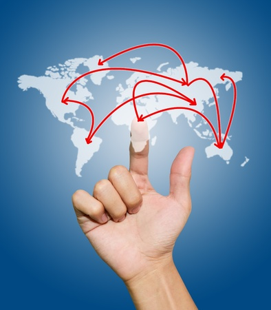 Hand with the map of social network on blue background photo