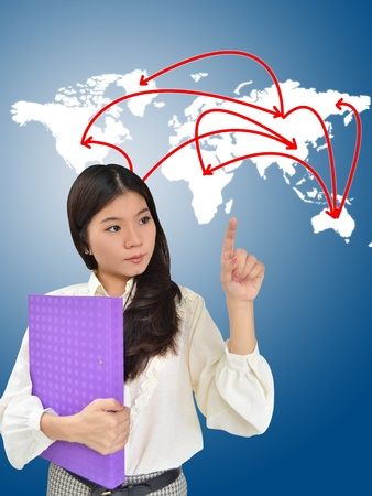 Business woman presenting network on world map photo