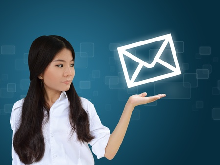 Business woman showing e-mail symbol photo