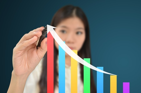upward graph: Business woman drawing a graph showing growth of business