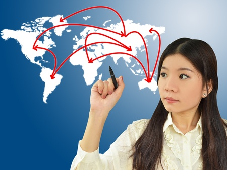 export import: Business woman drawing network on world map Stock Photo